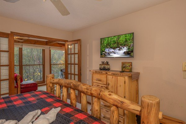 Dresser and TV in a bedroom at Lazy Bear Retreat, a 4 bedroom cabin rental located in Pigeon Forge