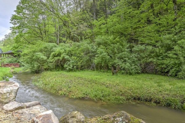 Creek nearby at Smokey Max Cabin, a 2 bedroom cabin rental located in Pigeon Forge