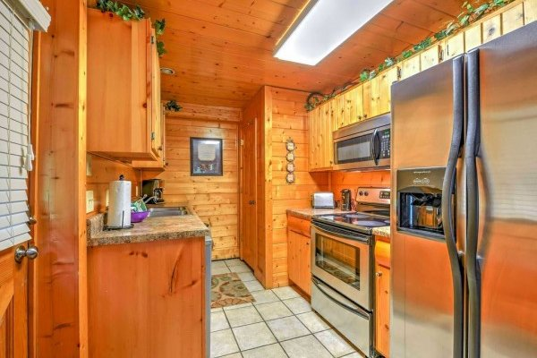 Kitchen with stainless appliances at Smokey Max Cabin, a 2 bedroom cabin rental located in Pigeon Forge