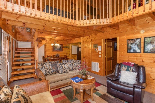 Living room and dining room at Smokey Max Cabin, a 2 bedroom cabin rental located in Pigeon Forge