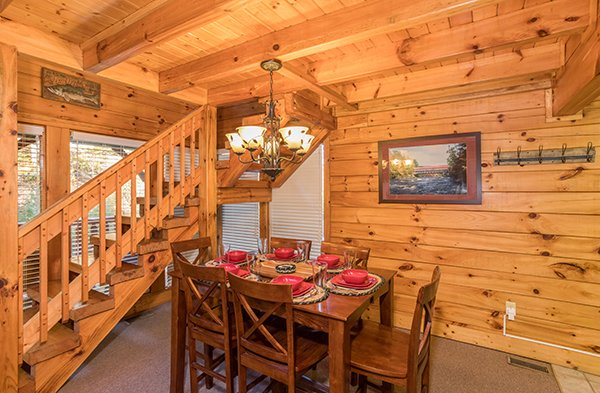 Dining table for six at Smokey Max Cabin, a 2 bedroom cabin rental located in Pigeon Forge