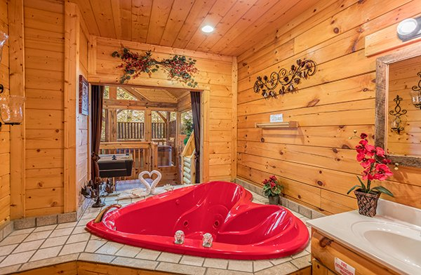 Heart shaped jacuzzi at Smokey Max Cabin, a 2 bedroom cabin rental located in Pigeon Forge
