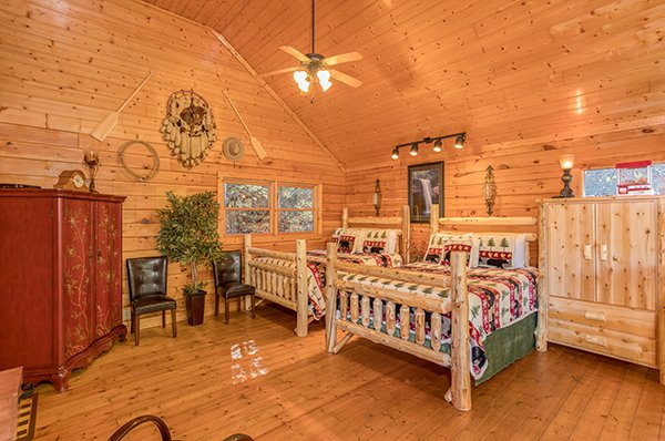Bedroom with two beds and armoires at Smokey Max Cabin, a 2 bedroom cabin rental located in Pigeon Forge