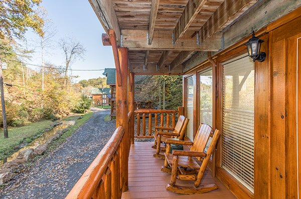 Deck rocking chairs at Smokey Max Cabin, a 2 bedroom cabin rental located in Pigeon Forge