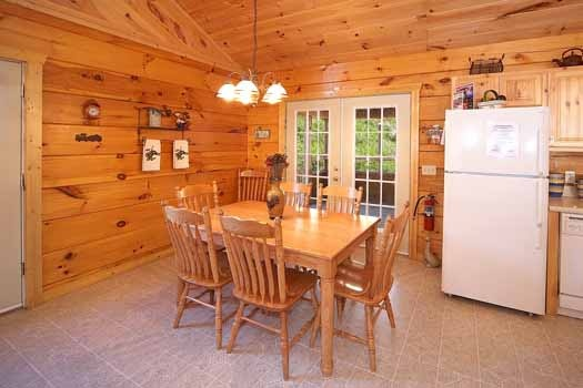 Dining table for six at Eagle's Loft, a 2-bedroom cabin rental located in Pigeon Forge
