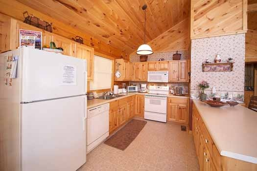 Kitchen with white appliances at Eagle's Loft, a 2-bedroom cabin rental located in Pigeon Forge