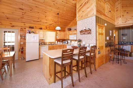 Kitchen bar with stools at Eagle's Loft, a 2-bedroom cabin rental located in Pigeon Forge