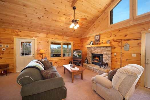 Living room with stone fireplace at Eagle's Loft, a 2-bedroom cabin rental located in Pigeon Forge