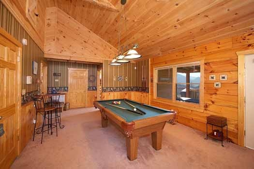 Pool table off the living room at Eagle's Loft, a 2-bedroom cabin rental located in Pigeon Forge