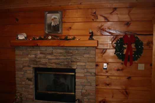 Stone fireplace in the living room at Eagle's Loft, a 2-bedroom cabin rental located in Pigeon Forge