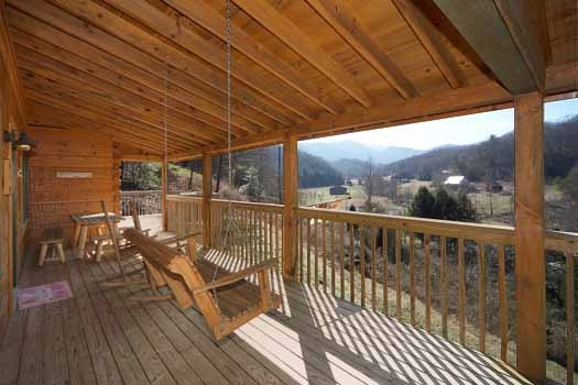Swing on covered deck at Eagle's Loft, a 2-bedroom cabin rental located in Pigeon Forge