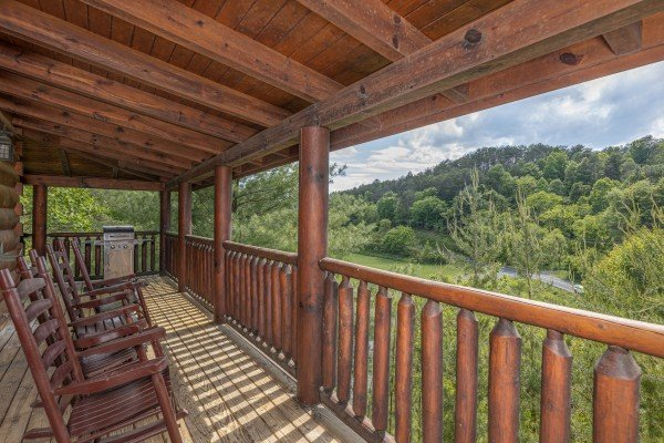 Covered porch with rocking chairs at Autumn Blessings, a 2 bedroom cabin rental located in Pigeon Forge