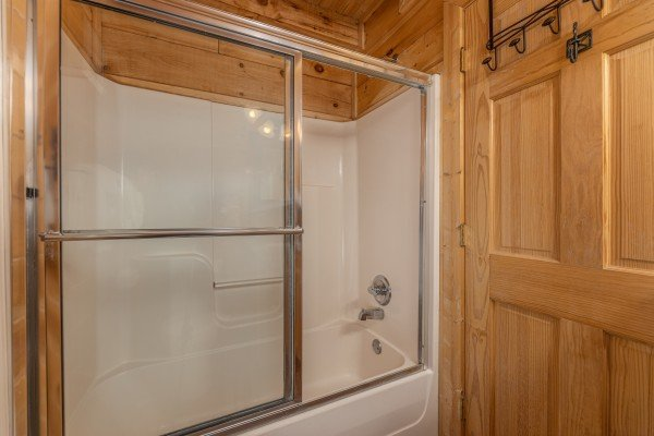Bathroom with a tub and shower at Autumn Blessings, a 2 bedroom cabin rental located in Pigeon Forge