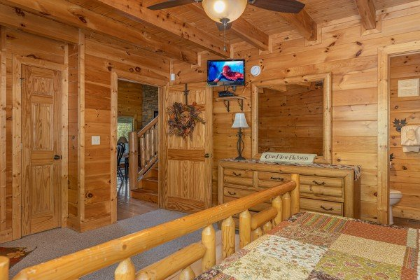 Dresser and TV in a bedroom at Autumn Blessings, a 2 bedroom cabin rental located in Pigeon Forge