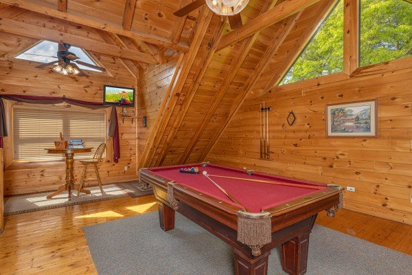 Loft with a pool table at Autumn Blessings, a 2 bedroom cabin rental located in Pigeon Forge