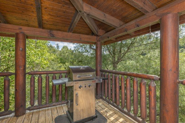 Grill on a covered deck at Autumn Blessings, a 2 bedroom cabin rental located in Pigeon Forge