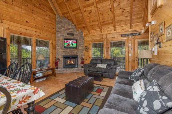 Living room with fireplace and TV at Autumn Blessings, a 2 bedroom cabin rental located in Pigeon Forge