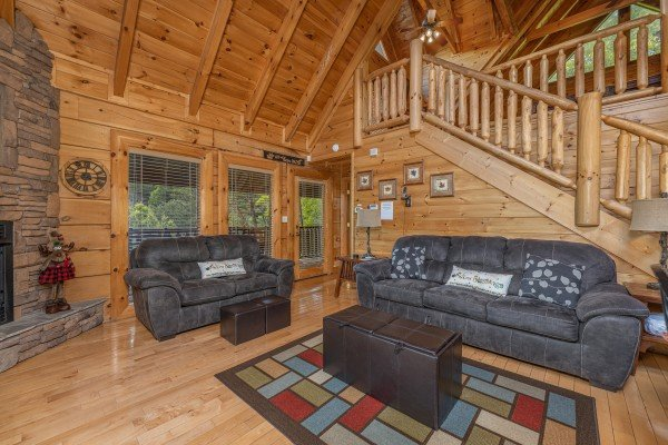 Living room sofa and loveseat at Autumn Blessings, a 2 bedroom cabin rental located in Pigeon Forge