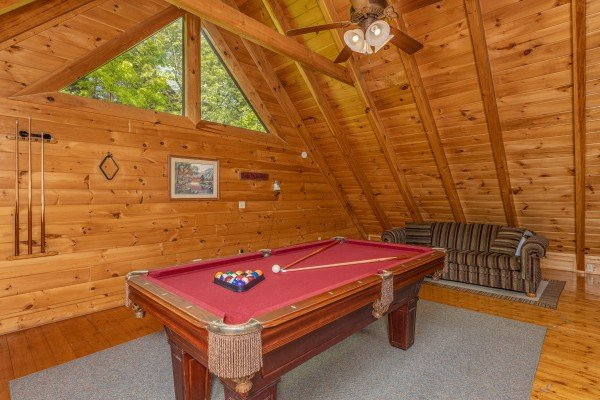 Pool table in the game loft at Autumn Blessings, a 2 bedroom cabin rental located in Pigeon Forge
