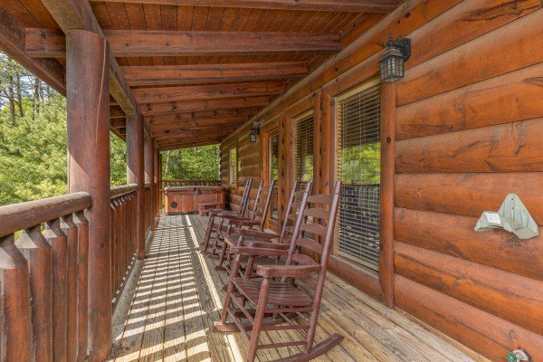 Rocking chairs on a covered porch at Autumn Blessings, a 2 bedroom cabin rental located in Pigeon Forge