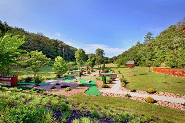 Putt putt course for guests at Autumn Blessings, a 2 bedroom cabin rental located in Pigeon Forge