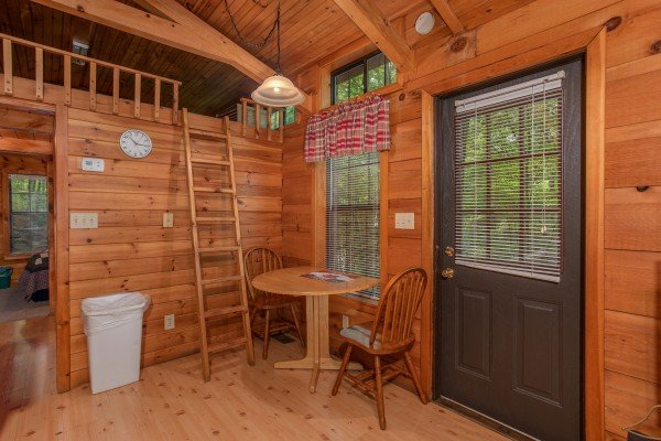 dining room for two with ladder to the loft angel's dream a 1 bedroom cabin rental located in gatlinburg