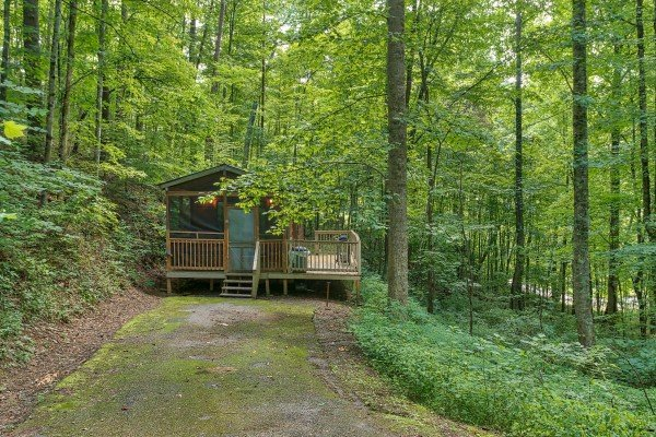 exterior view of the cabin and flat parking at angel's dream a 1 bedroom cabin rental located in gatlinburg