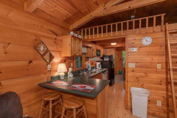 barstool seating for two and kitchen at angel's dream a 1 bedroom cabin rental located in gatlinburg