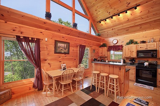 Dining area and island at Tranquility, a 2 bedroom cabin rental located in Gatlinburg