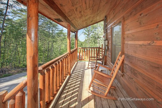 First floor deck with rockers at Tranquility, a 2 bedroom cabin rental located in Gatlinburg