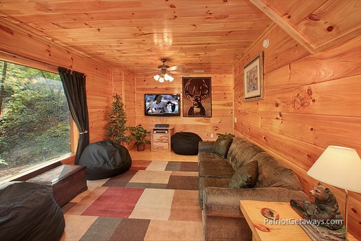 first floor game room with sofa bed at tranquility a 2 bedroom cabin rental located in gatlinburg