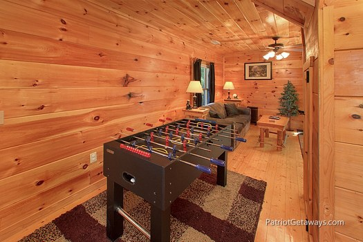 game room with foosball table at tranquility a 2 bedroom cabin rental located in gatlinburg