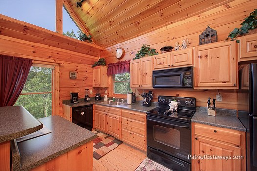 kitchen with island at tranquility a 2 bedroom cabin rental located in gatlinburg