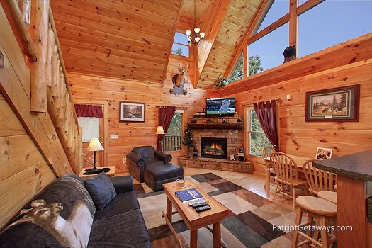 living room with fireplace at tranquility a 2 bedroom cabin rental located in gatlinburg