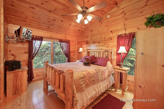 lofted queen bedroom with ensuite bath at tranquility a 2 bedroom cabin rental located in gatlinburg