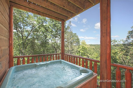Lower level deck with hot tub at Tranquility, a 2 bedroom cabin rental located in Gatlinburg