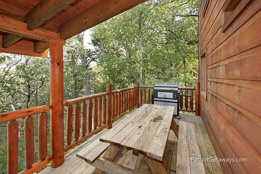 Main level deck with picnic table at Tranquility, a 2 bedroom cabin rental located in Gatlinburg