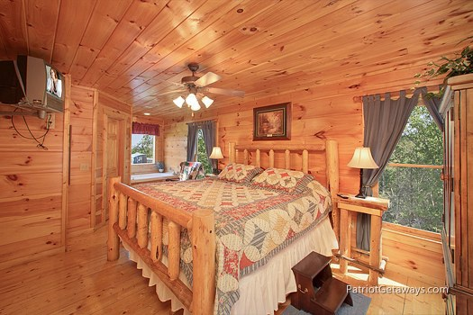 master bedroom with king bed at tranquility a 2 bedroom cabin rental located in gatlinburg