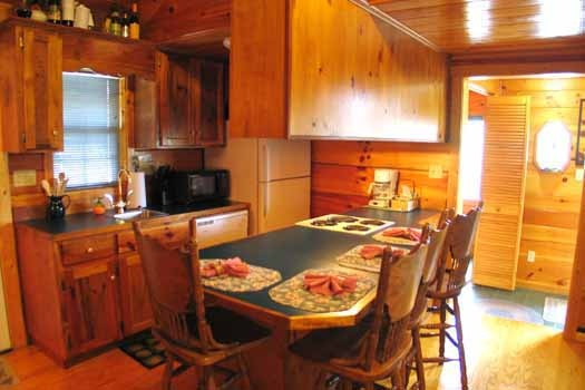 Dining counter for four at Just Us, a 1 bedroom cabin rental located in Pigeon Forge