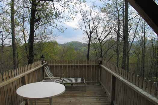 Patio furniture at Just Us, a 1 bedroom cabin rental located in Pigeon Forge