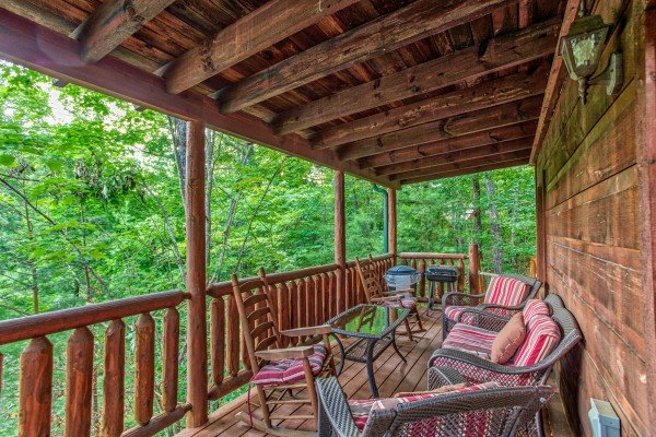 Covered deck with plenty of seating at Ivy Lodge, a 1 bedroom cabin rental located in Pigeon Forge
