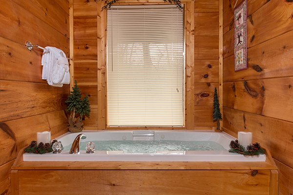 Jacuzzi in the main floor king bedroom at Ivy Lodge, a 1 bedroom cabin rental located in Pigeon Forge