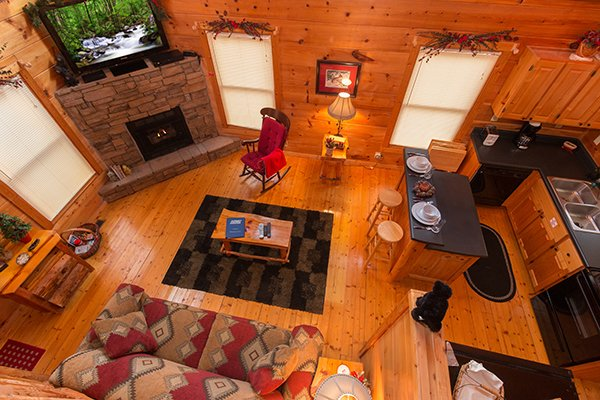 Looking down into the living room from the loft bedroom at Ivy Lodge, a 1 bedroom cabin rental located in Pigeon Forge