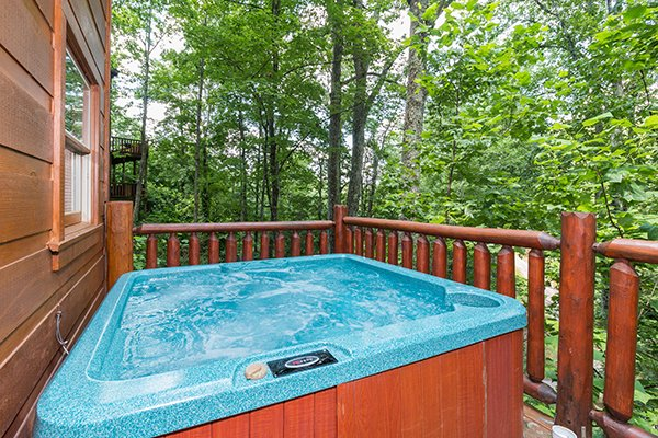 Hot tub on the deck at Fallin' in Love, a 1-bedroom cabin rental located in Gatlinburg
