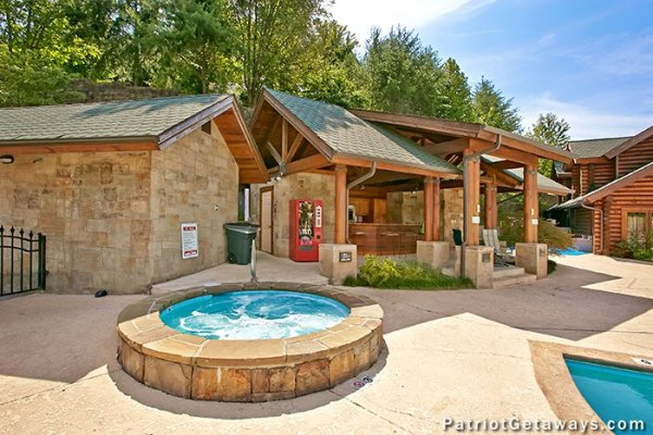 Resort outdoor spa at the pool at Hibernation Hideaway #745, a 2-bedroom Pigeon Forge cabin rental