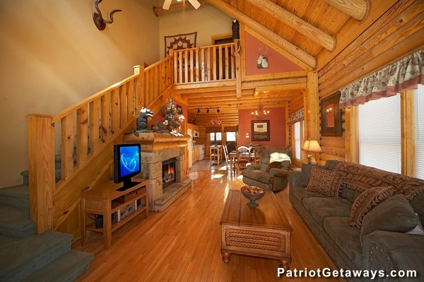 Open concept main floor Hibernation Hideaway #745, a 2-bedroom cabin rental located in Pigeon Forge