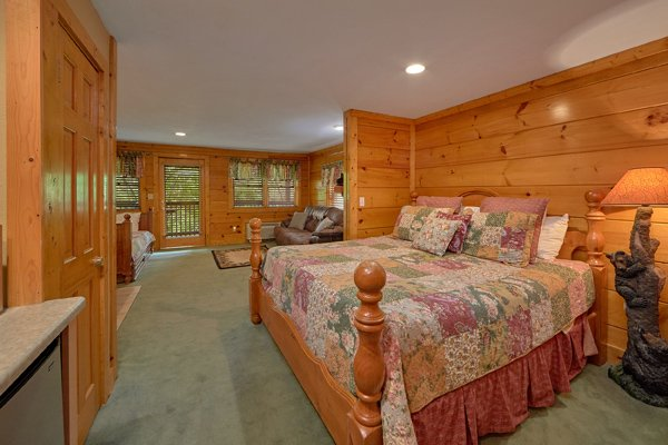 Basement bedroom with a king bed, twin trundle, and jacuzzi at Hibernation Hideaway #745, a 2-bedroom cabin rental located in Pigeon Forge