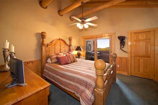 Deck access from third floor bedroom at Hibernation Hideaway #745, a 2-bedroom cabin rental located in Pigeon Forge