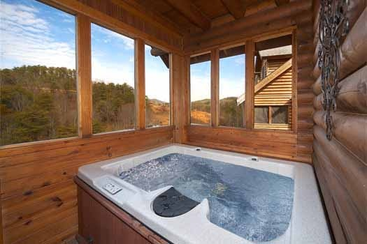 Hot tub on screened deck at Hibernation Hideaway #745, a 2-bedroom Pigeon Forge cabin rental