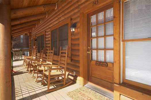 rockers on the front porch at hibernation hideaway #745 a 2 bedroom cabin rental located in pigeon forge